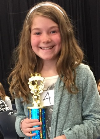Spelling Bee runner up holding trophy